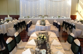 Wedding Venue - Shangri La Gardens  - Regency Room 2 - Regency Room with Black Sashes & Fairy Light Swagging on Veilability